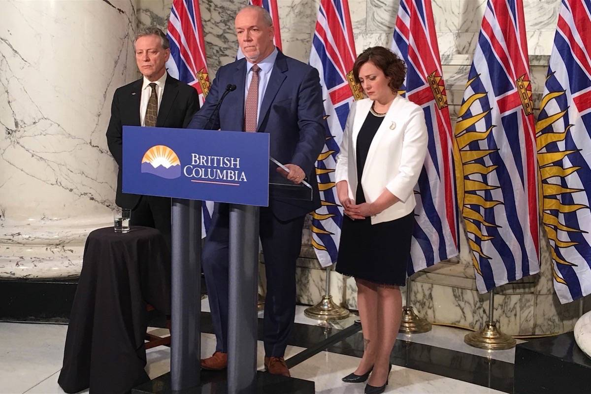 Environment Minister George Heyman, Premier John Horgan and Energy Minister Michelle Mungall announce that B.C. Hydro is proceeding with construction of the Site C dam, Dec. 11, 2017. (Tom Fletcher/Black Press)