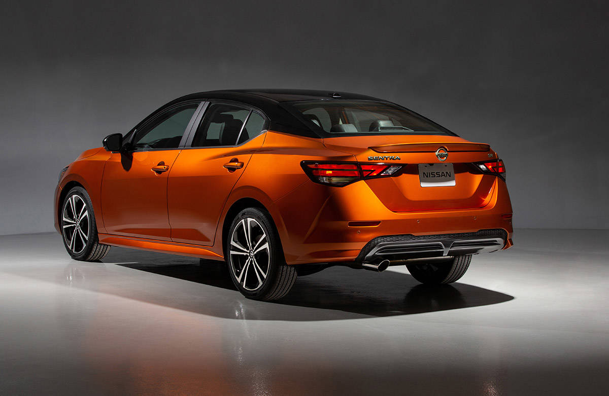 """The 2020 Sentra's design is leaner and more stylish, including fender creases and a tapered """"floating"""" roofline that elegantly blends into the trunk."""
