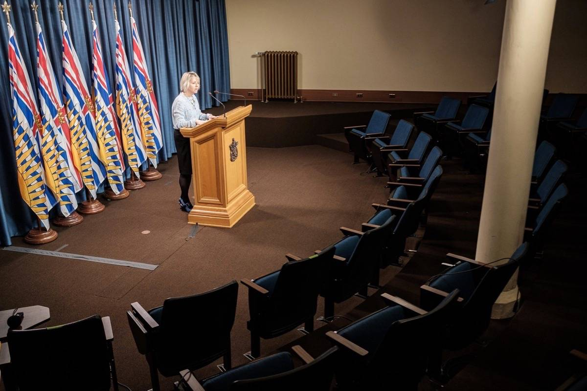 B.C. provincial health officer Dr. Bonnie Henry gives a daily briefing on COVID-19 cases at an almost empty B.C. Legislature press theatre in Victoria, B.C., on March 25, 2020. (Don Craig/B.C. government)