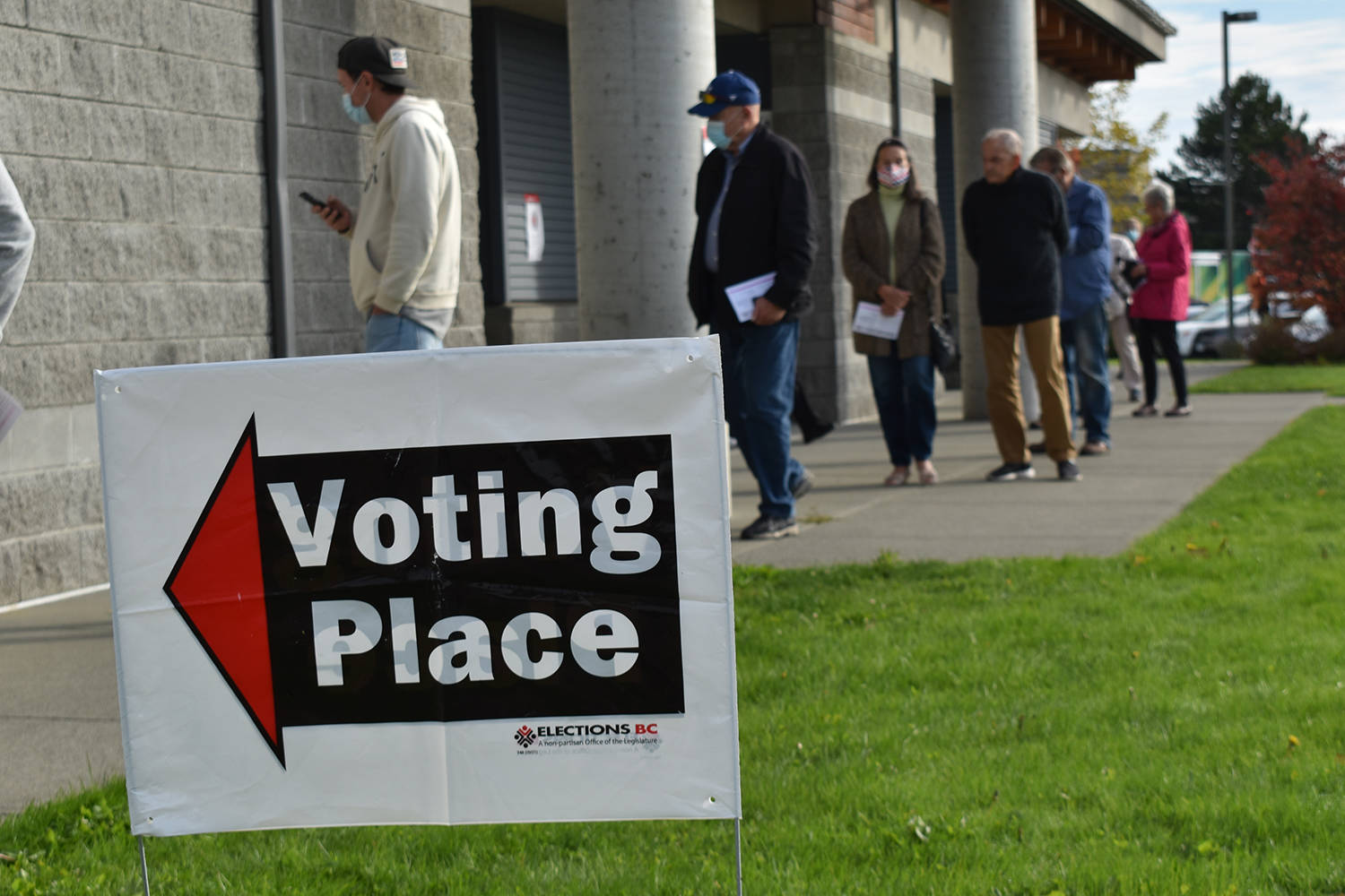 Voters lined up on the first day of advanced voting to cast their ballot in the 2020 provincial election. Today is general election day, province-wide, and those heading to the polls are asked to respect safety precautions. (Wolf Depner/Black Press Media files)