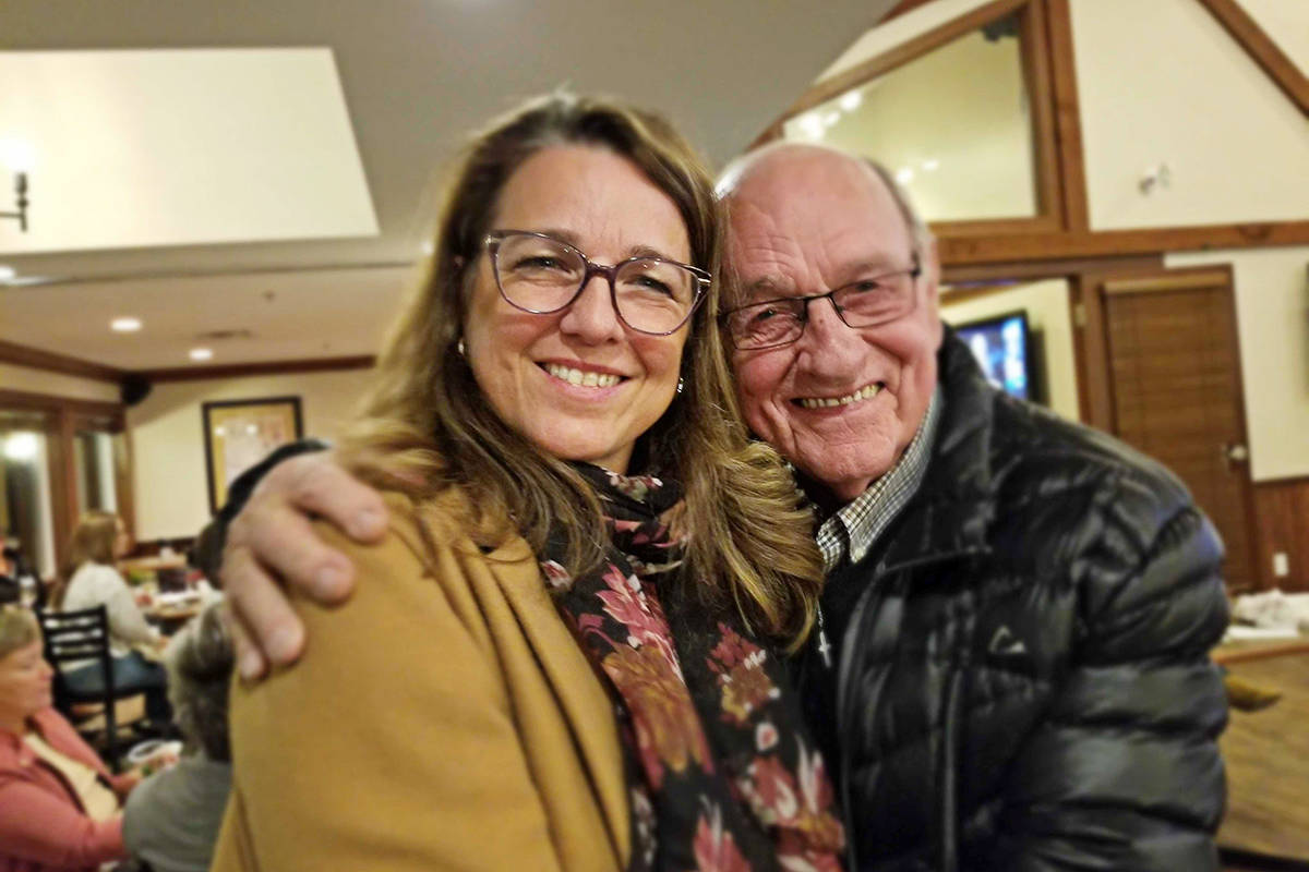 Liberal Margaret Kunst got a hug of encouragement from dad Ted VanderHoek while she watched the election results. (Dan Ferguson/Langley Advance Times)