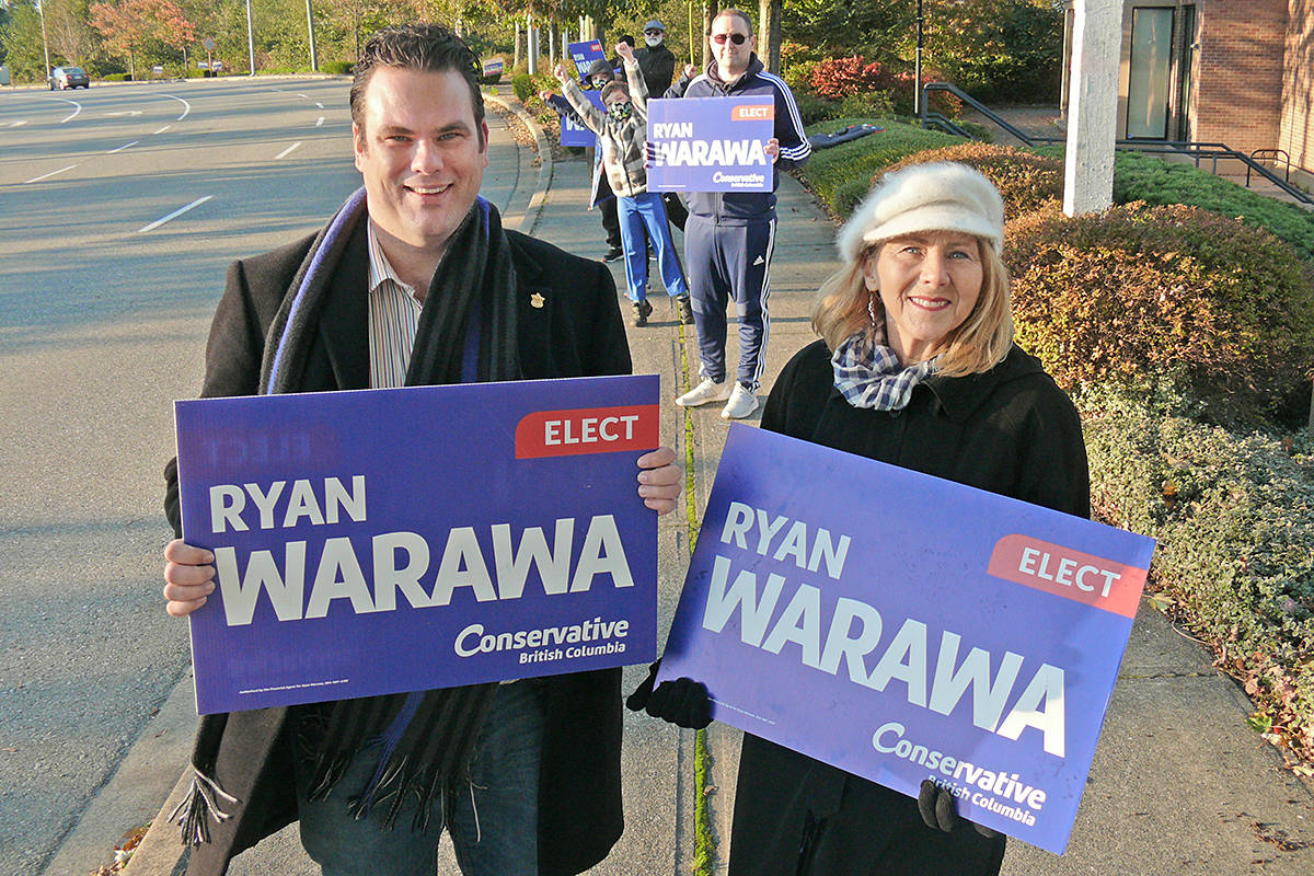 Ryan Warawa, with mother Diane Warawa, was waving signs on 88 Avenue near 200 St on Saturday, Oct. 24, 2020 (Dan Ferguson/Langley Advance Times)