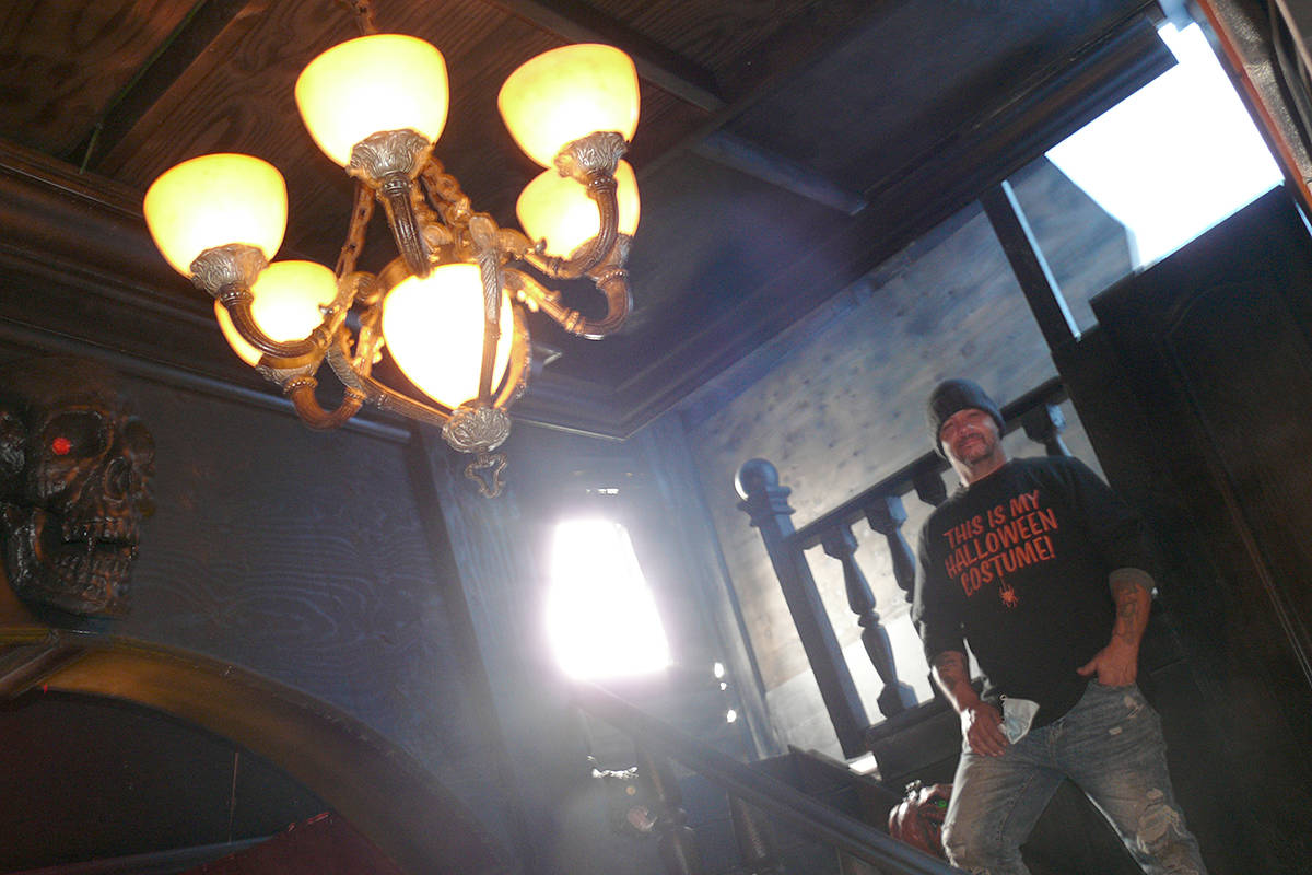 Barry Brinkwater with a chandelier from a real-life haunted house that has been added to the Brinkworth Dungeon at 22260 48th Ave (Dan Ferguson/Langley Advance Times)