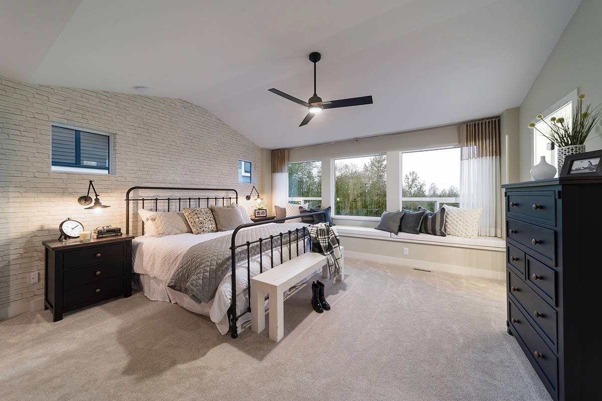 Master bedroom retreats include a sitting room, walk-in closet and spa-like ensuite.