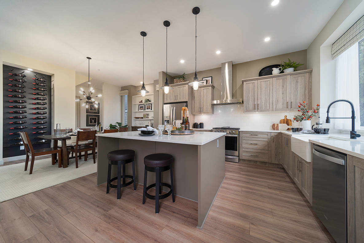 Open-concept plans include huge kitchen islands meant for eating, entertaining or just hanging out together.