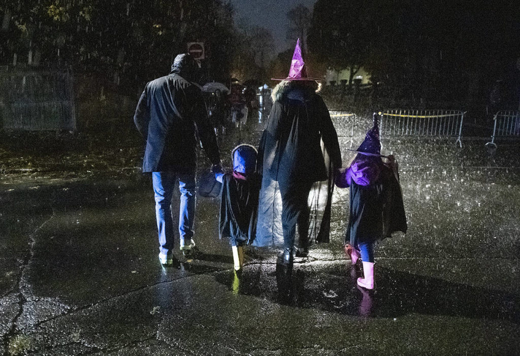 FILE – People go trick or treating in the rain on Halloween in Ottawa, on Thursday, Oct. 31, 2019. THE CANADIAN PRESS/Justin Tang