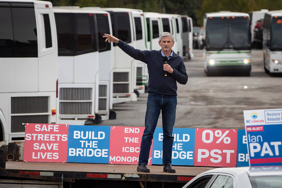 B.C. Liberal Leader Andrew Wilkinson speaks during a drive-in car rally campaign stop at a tour bus operator, in Delta, Saturday, Oct. 17, 2020. THE CANADIAN PRESS/Darryl Dyck