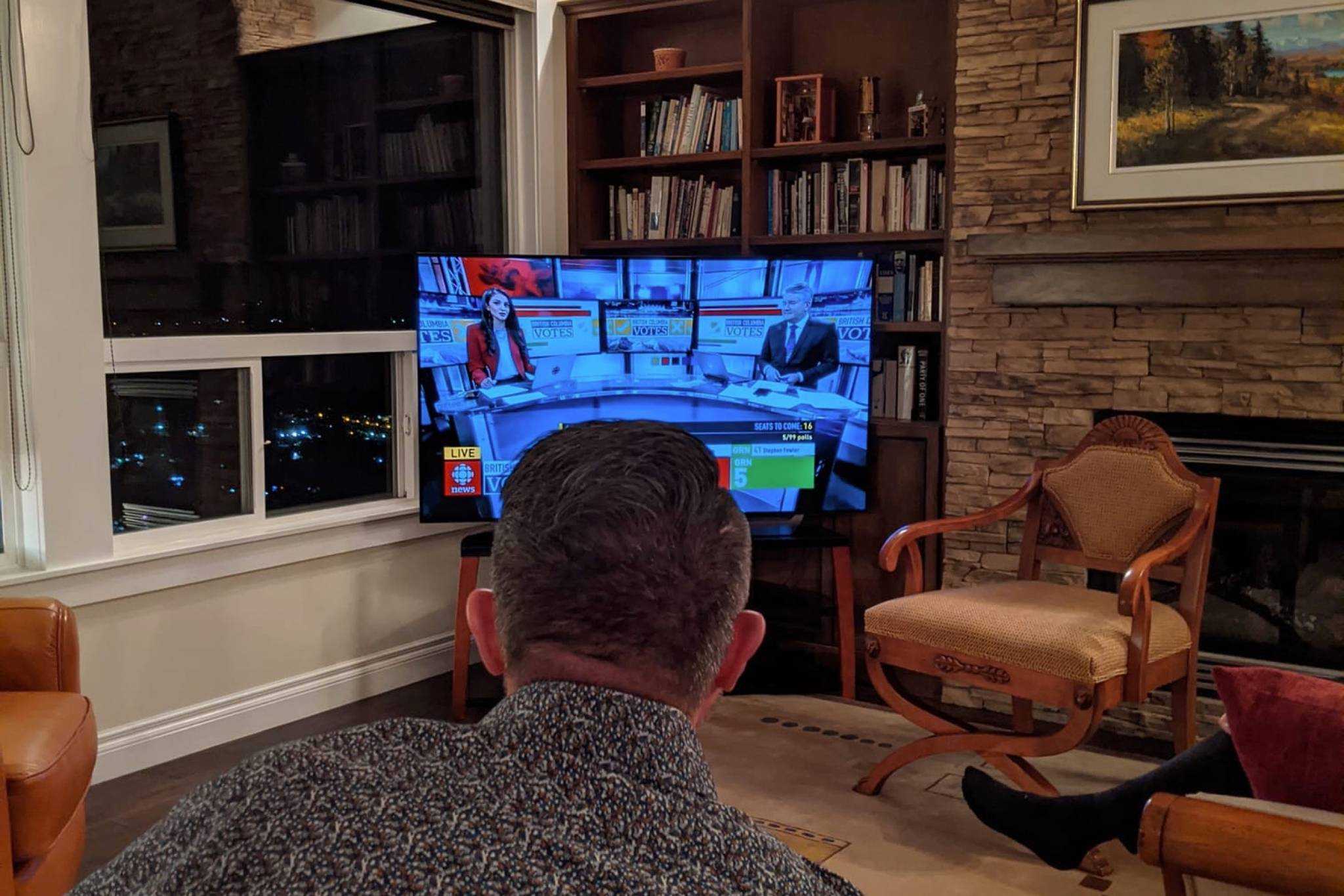 Chilliwack-Kent MLA Laurie Throness watches the results on election night. The ex-Liberal's tumultuous campaign and the narrow margin for victory ahead of the mail-in ballot count leaves the future of the riding's seat in limbo for at least the next week. (Facebook/Laurie Throness)
