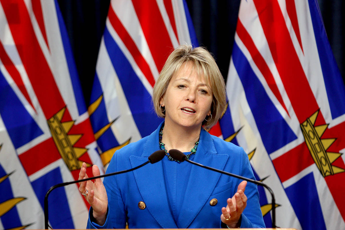 FILE – Provincial Health Officer Dr. Bonnie Henry provides the latest update on the COVID-19 pandemic in the province during a press conference in the press theatre at Legislature in Victoria, B.C., on Thursday, October 22, 2020. THE CANADIAN PRESS/Chad Hipolito