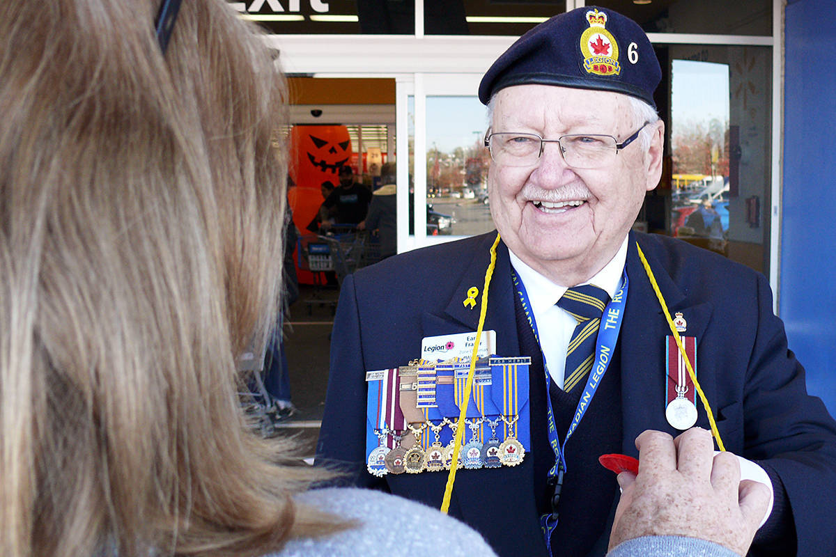 Earle Fraser, Cloverdale Legion poppy chair, seen here distributing poppies in 2019, said the donation drive has to be done differently during the pandemic (Langley Advance Times file)