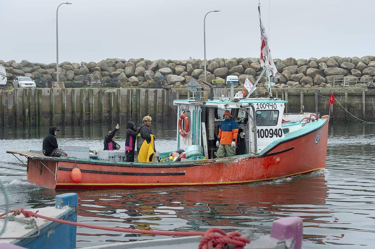 Indigenous fishermen head from the harbour in Saulnierville, N.S. on Wednesday, Oct. 21, 2020. A First Nation in Nova Scotia that was struggling to sell its lobster harvest amid tensions over its self-regulated fishery says it has managed to find a buyer for a portion of its catch. THE CANADIAN PRESS /Andrew Vaughan