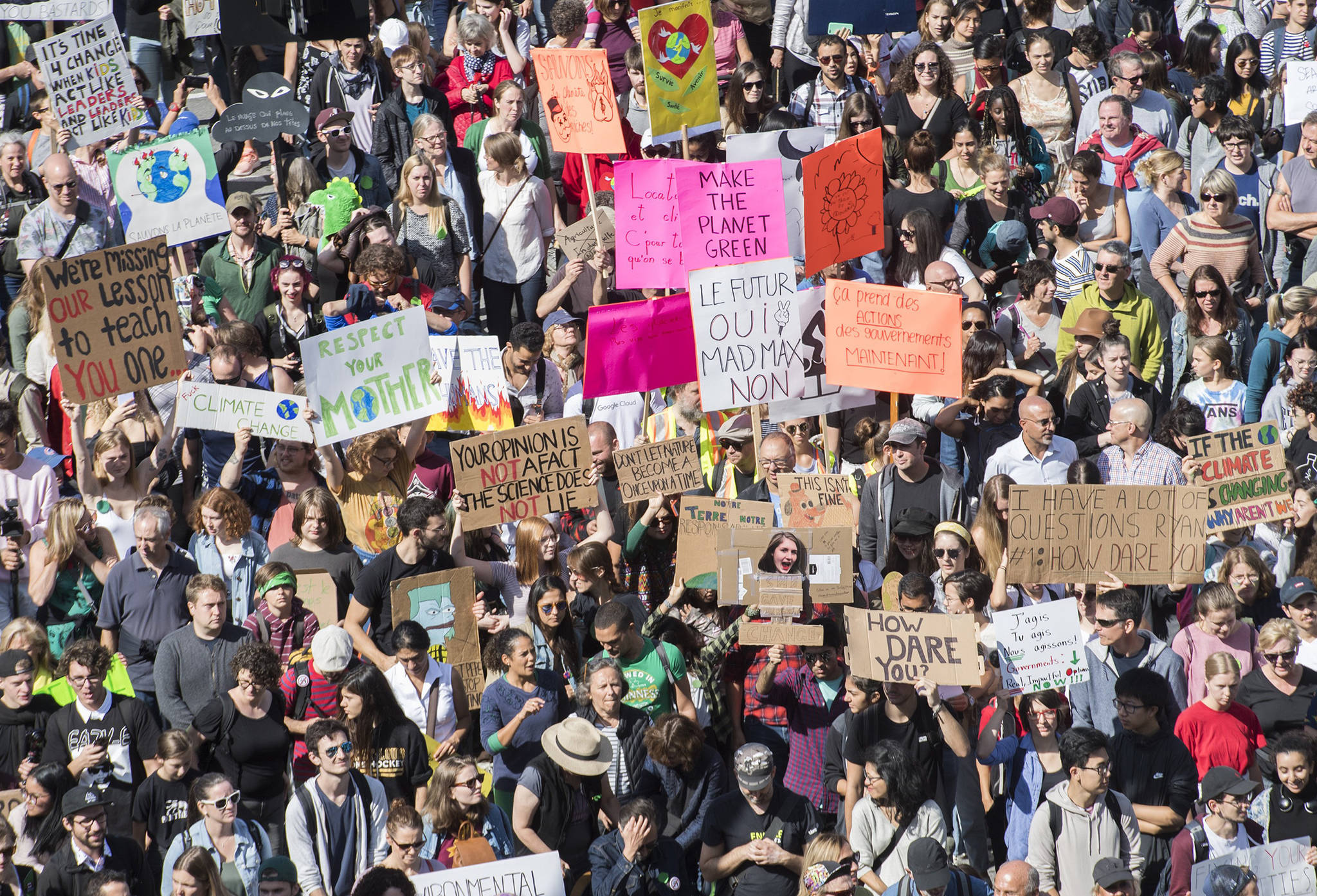 People march during a climate strike in Montreal, Friday, Sept. 27, 2019. THE CANADIAN PRESS/Graham Hughes