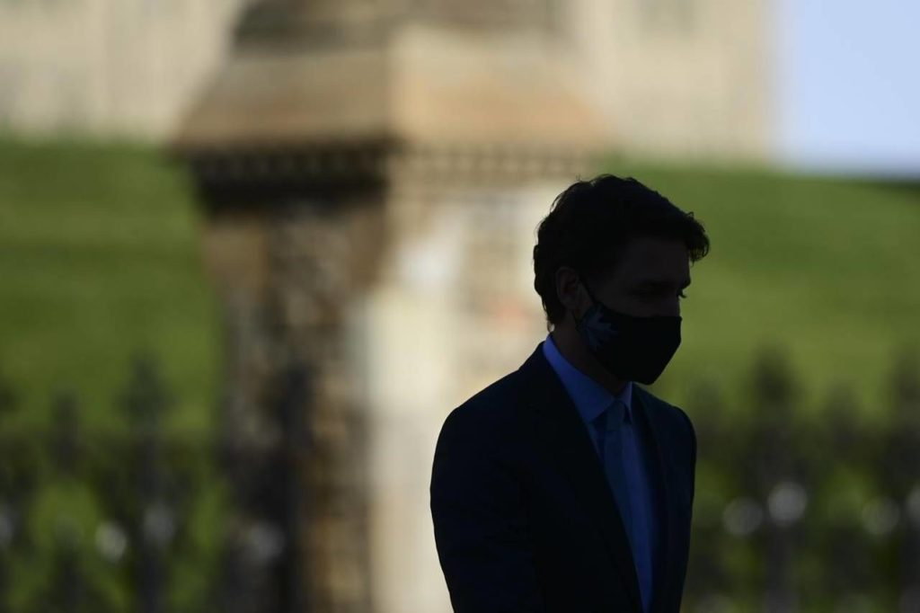 Prime Minister Justin Trudeau makes his way to provide an update on the COVID pandemic in Ottawa on Tuesday, Oct. 27, 2020. Canada has reached a grim milestone in the COVID-19 pandemic, surpassing 10,000 novel coronavirus deaths. THE CANADIAN PRESS/Sean Kilpatrick