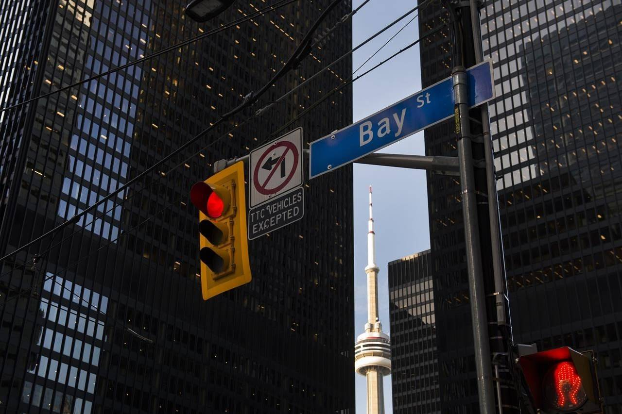 A traffic light on Bay Street in Canada's financial district is shown in Toronto on Wednesday, March 18, 2020. A new report says a culture of inequality continues to persist in Canada's capital markets and the brunt of it is felt by women and people who are racialized, Indigenous or identify as LGBTQ2S+. THE CANADIAN PRESS/Nathan Denette