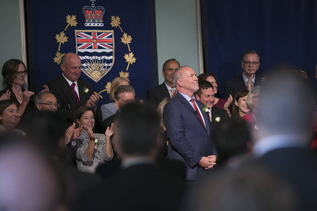 Premier-elect John Horgan and cabinet ministers are sworn in for the first time at Government House in Victoria, July 18, 2017. (Arnold Lim/Black Press)
