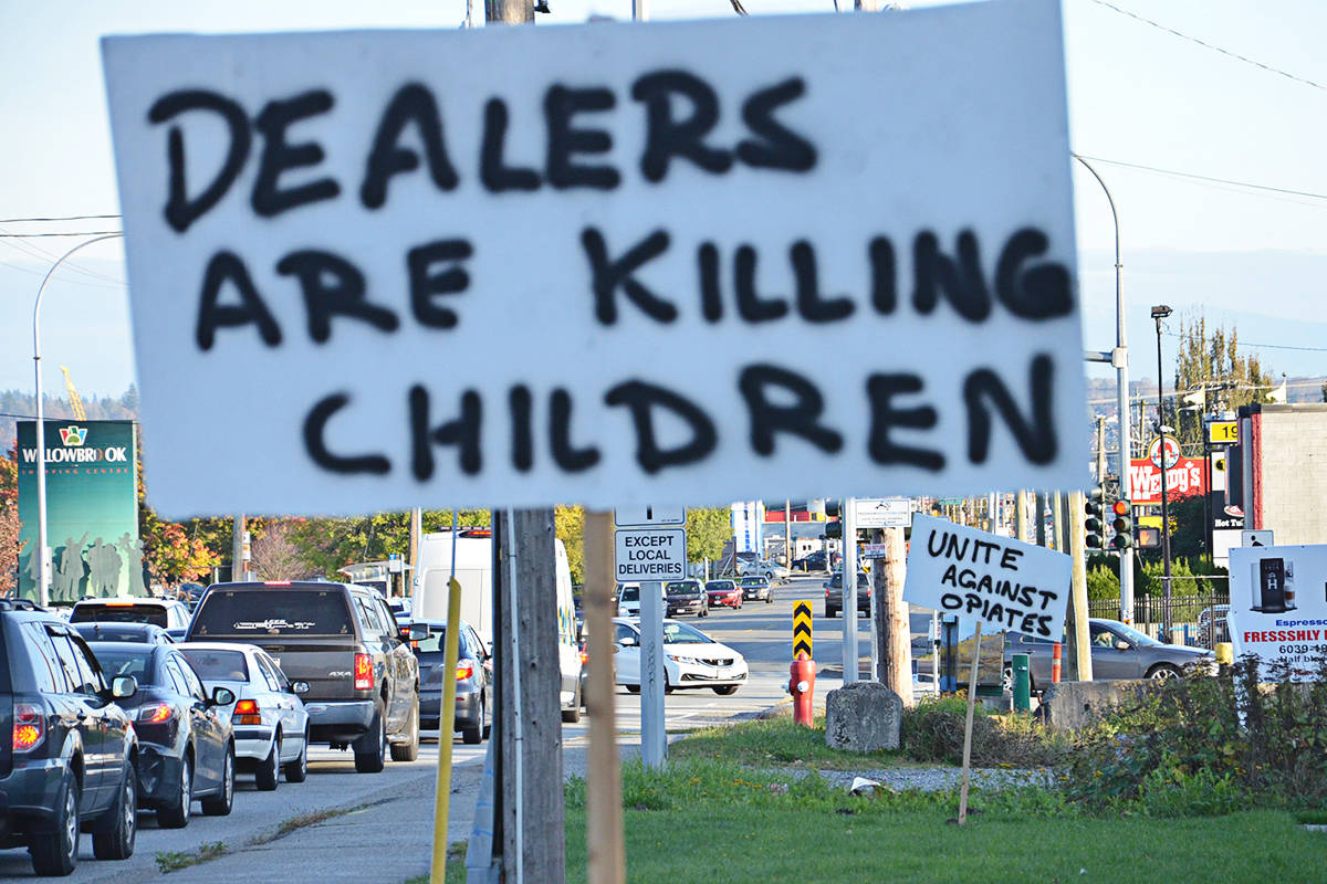 Motorists heading east on Fraser Highway saw signs in the 19500 block calling out drug dealers for harming children. (Heather Colpitts/Langley Advance Times)