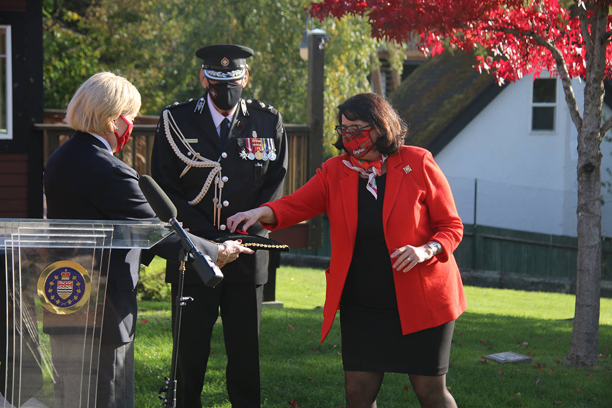 Valerie McGregor, president of the B.C. Yukon Command of the Royal Canadian Legion, presented Austin with the poppy. (Kendra Crighton/News Staff)