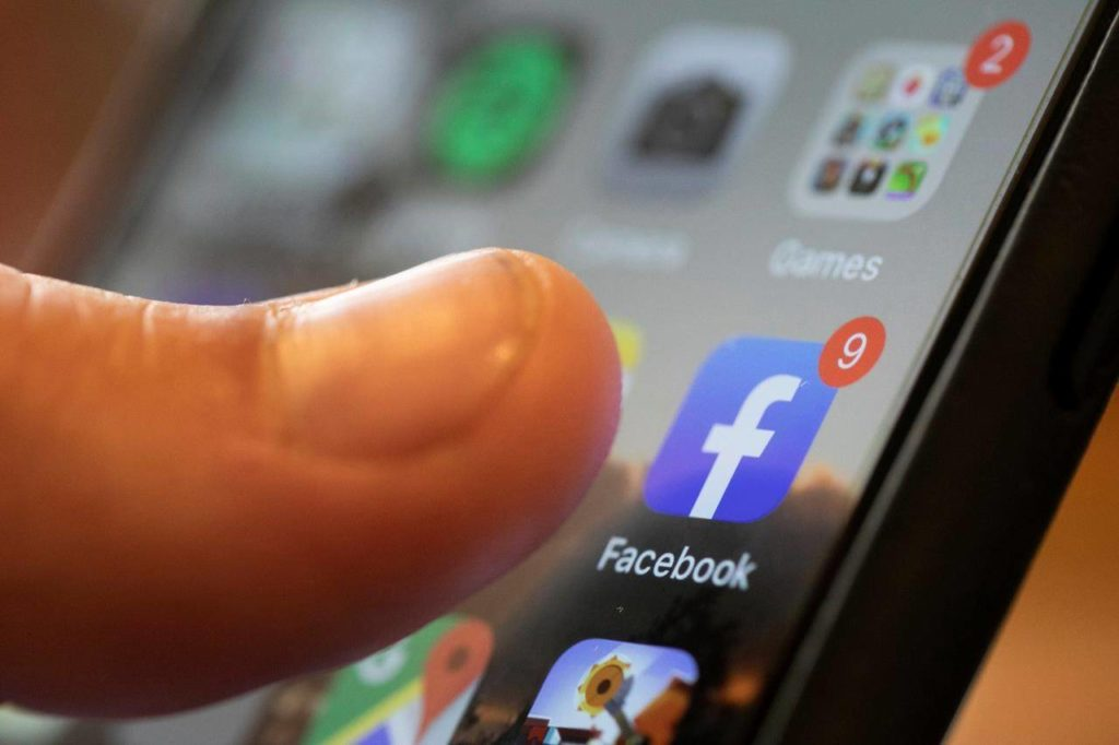 An iPhone displays the Facebook app in New Orleans on Aug. 11, 2019. Two Facebook users are seeking damages on behalf of hundreds of thousands of Canadians whose personal data may have been improperly used for political purposes. THE CANADIAN PRESS/AP, Jenny Kane