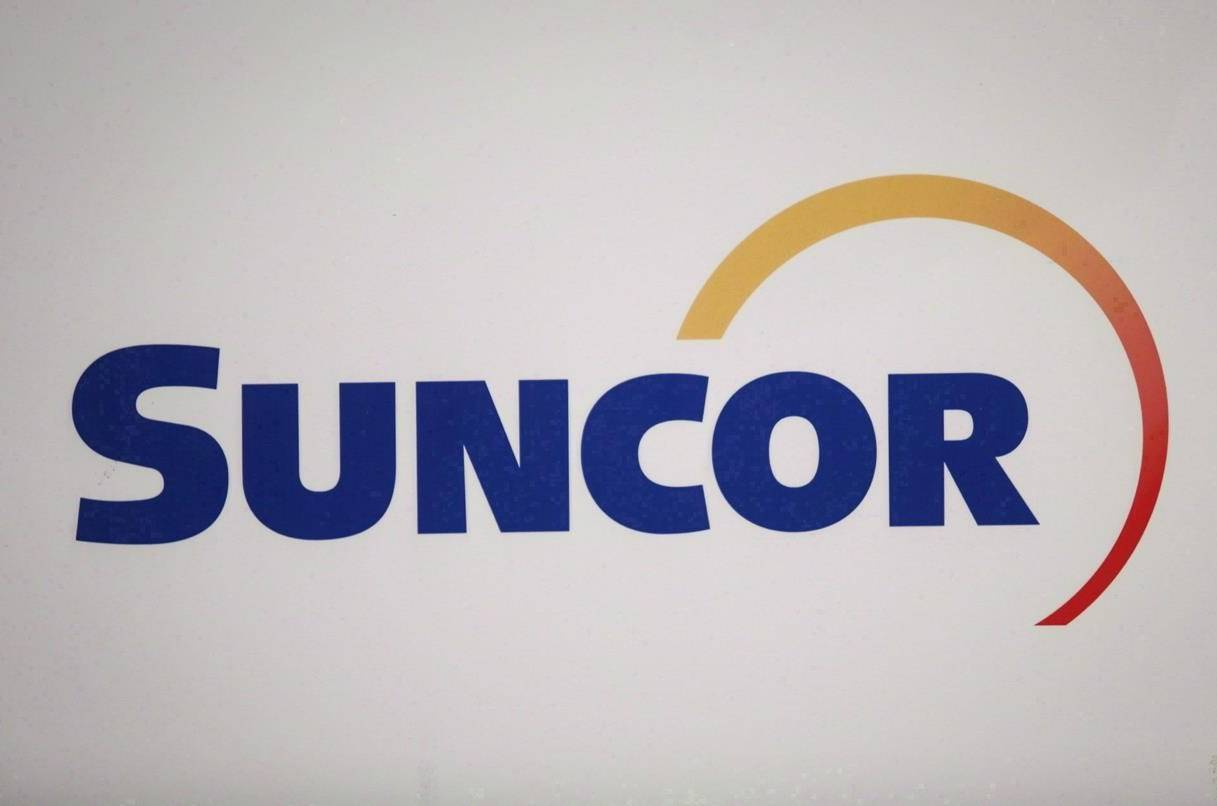 Suncor Energy Inc.'s logo is shown at the company's annual meeting in Calgary on April 27, 2017.THE CANADIAN PRESS/Jeff McIntosh