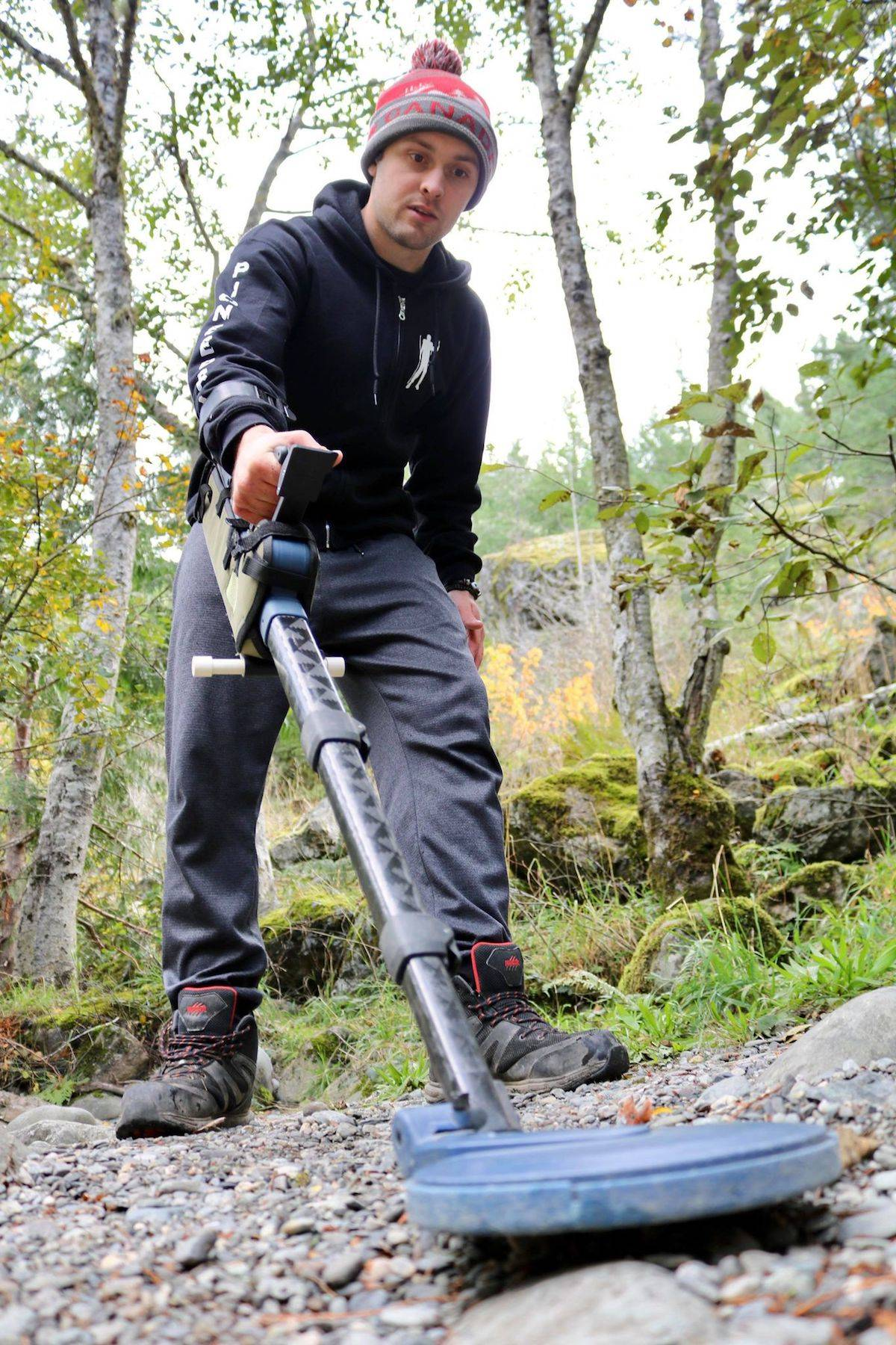 Sooke's Paul Larouche, aka PioneerPauly on YouTube, uses a metal detector in hopes to find gold flakes along his claim of the Sooke River. (Aaron Guillen/News Staff)