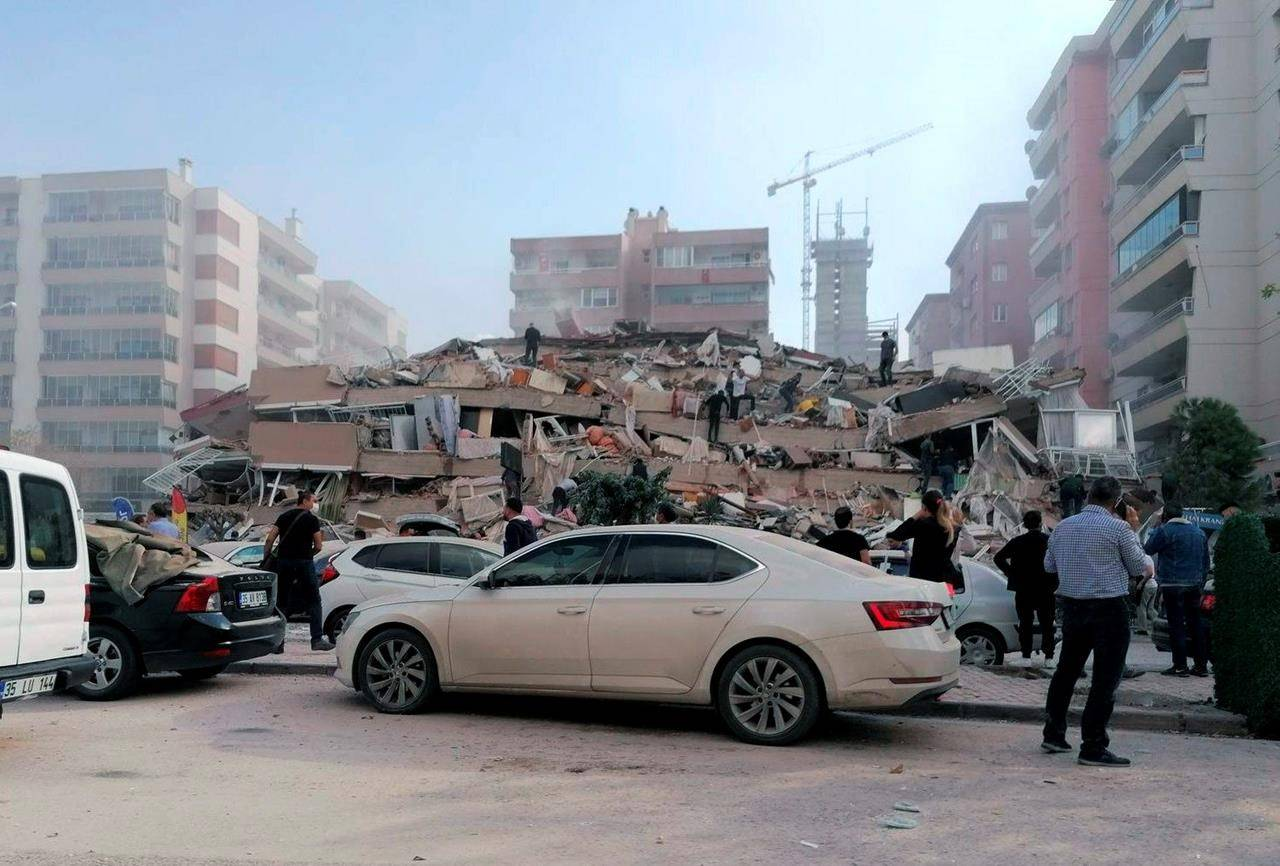 People work on a collapsed building, in Izmir, Turkey, Friday, Oct. 30, 2020, after a strong earthquake in the Aegean Sea has shaken Turkey and Greece. Turkey's Disaster and Emergency Management Presidency said Friday's earthquake was centered in the Aegean at a depth of 16.5 kilometers (10.3 miles) and registered at a 6.6 magnitude.(DHA via AP)