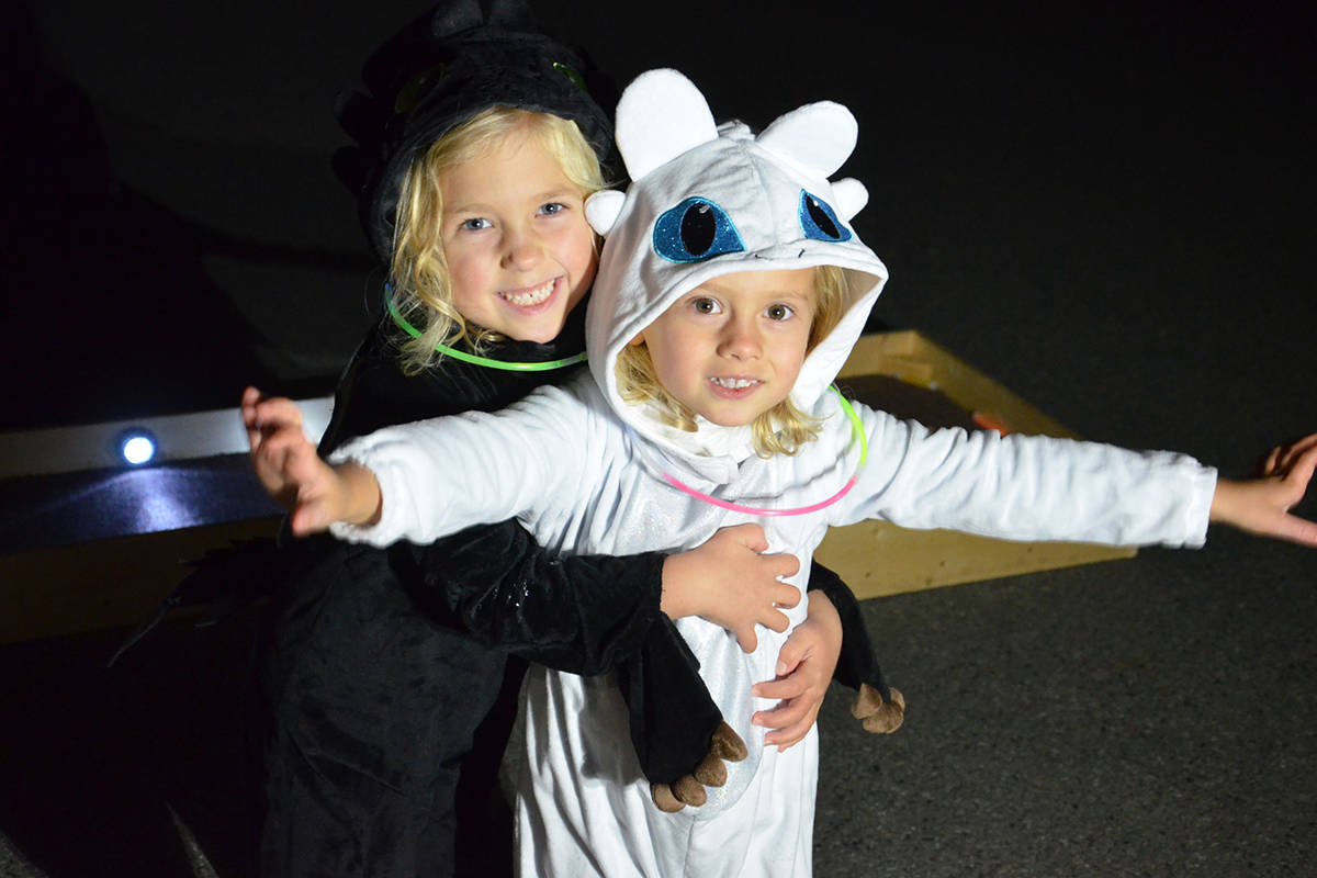 Sadie and Madelyn White both wore dragon costumes when their family visited South Ridge Church for the Pumpkin Fest family fun evening Friday. (Heather Colpitts/Langley Advance Times)