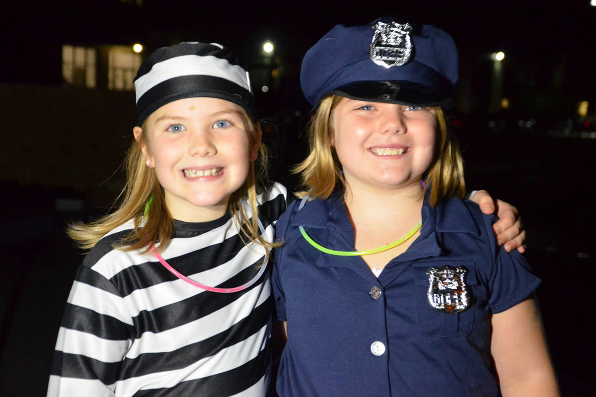 Brynna and Kinley Giesbrecht had fun in their costumes and playing games at South Ridge Church on Friday evening. (Heather Colpitts/Langley Advance Times)