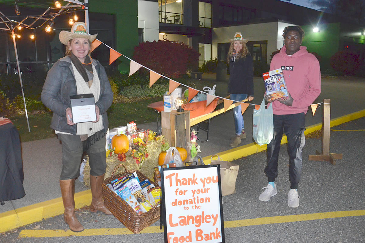 Kathleen McMillan, Julie Olson and her son, Elijah Olson, greeted people to the family drive-thru event at South Ridge Church on Friday, Oct. 30, 2020 (Heather Colpitts/Langley Advance Times)
