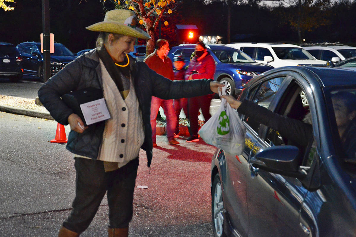 Kathleen McMillan and other volunteers at South Ridge Church accepted food and cash donations that will go to the Langley Food Bank. The donations were collected at the church Pumpkin Fest on Friday, Oct. 30, 2020 (Heather Colpitts/Langley Advance Times)