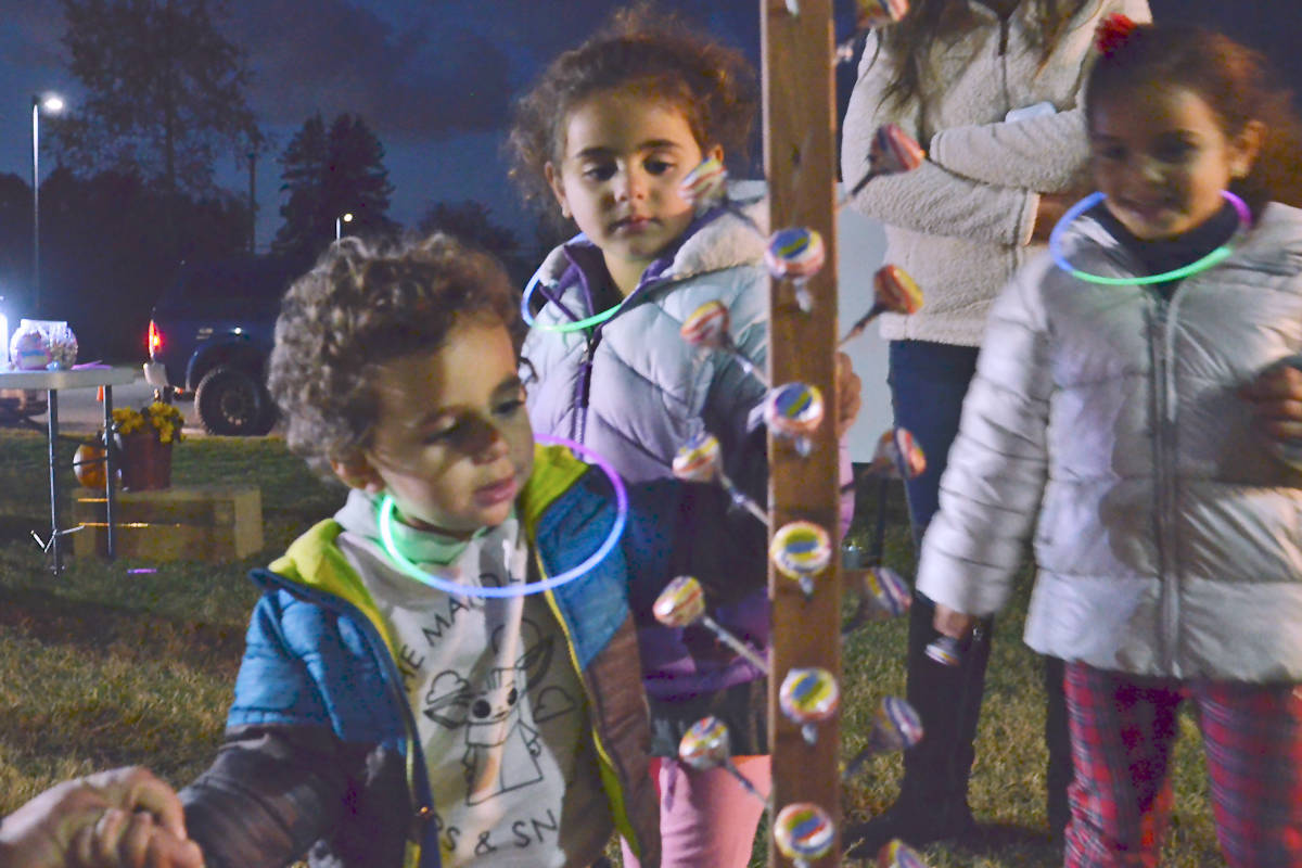 Eliano, Ivana and Olena Hanna got to select their candy prize after a game at the Pumpkin Fest Friday, Oct. 30, 2020. (Heather Colpitts/Langley Advance Times)