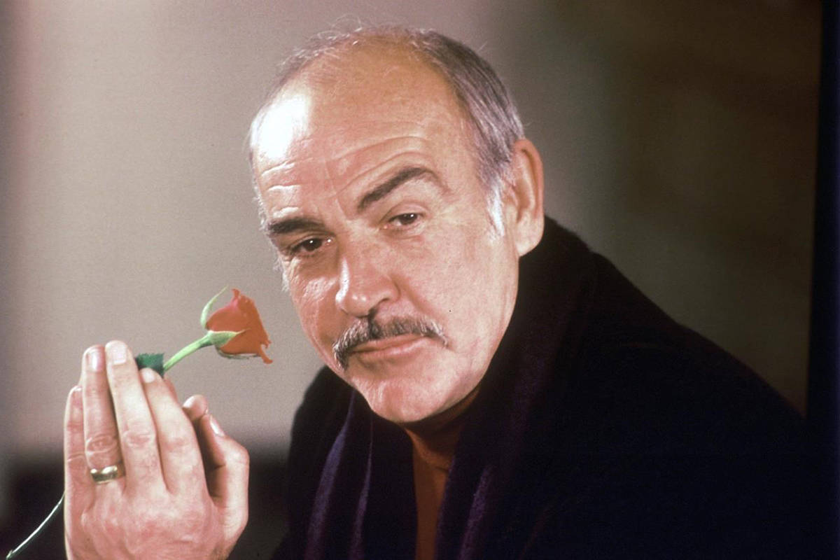 "FILE - In this Jan. 23, 1987 file photo, actor Sean Connery holds a rose in his hand as he talks about his new movie ""The Name of the Rose"" at a news conference in London. Scottish actor Sean Connery, considered by many to have been the best James Bond, has died aged 90, according to an announcement from his family. (AP Photo/Gerald Penny, File)"