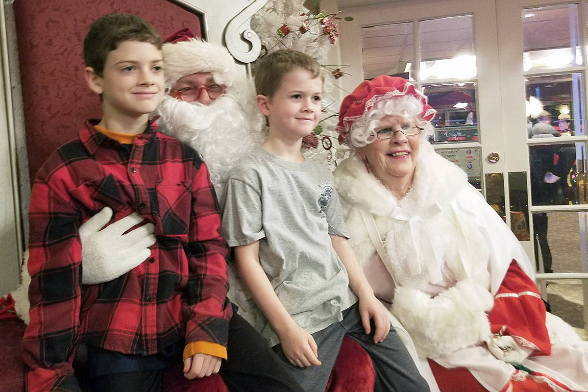 In 2019, Santa and Mrs. Claus posed for photos with young guests after families dropped off toy donations and enjoyed a free breakfast at the third annual Christmas Wish Breakfast hosted at Newlands Golf & Country Club in support of the Langley Christmas Bureau. (Langley Advance Times file)