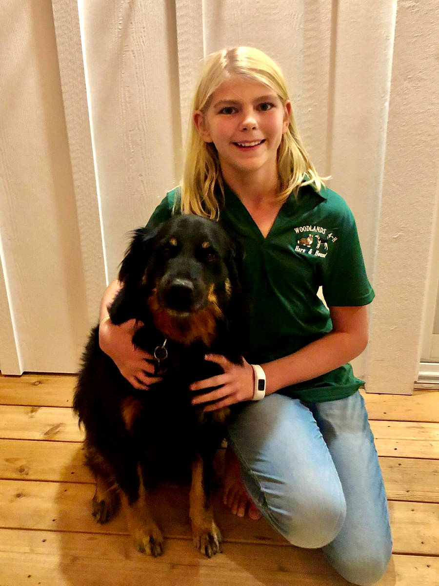 Laura Vis, a Woodlands Hare Hound member, shows off her project and her 4-H pride. (Lara Vis/Special to the Aldergrove Star)
