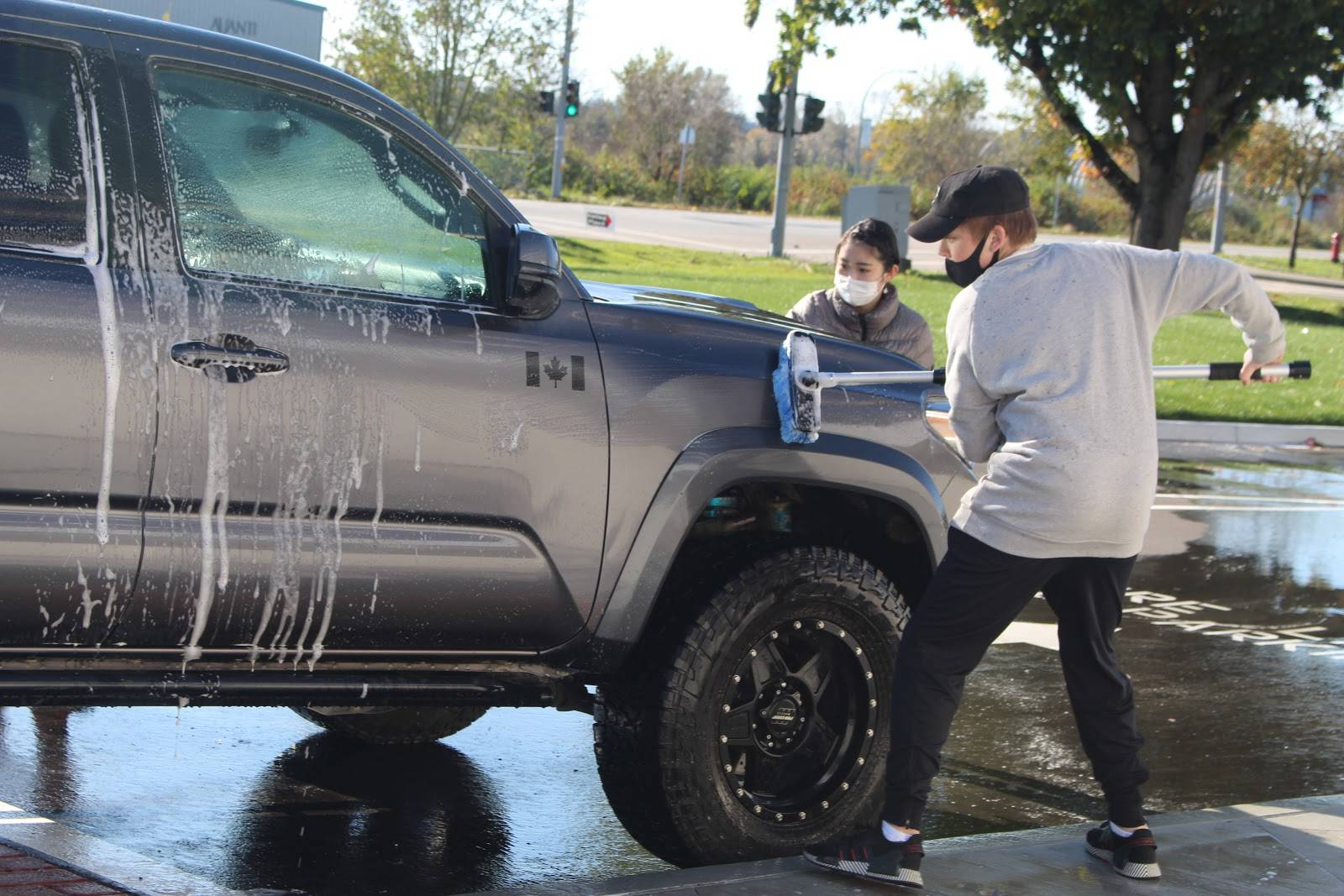 Students at Langley Secondary School held a car wash fundraiser on the weekend of Oct. 24 and 25 to raise money for Cystic Fibrosis Canada. (Erin Florko/Special to Langley Advance Times)