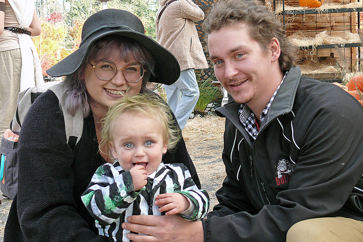 One-year-old Atlin from Maple Ridge, seen here with mom and dad, was dressed up as the best-looking Beetlejuice ever (Dan Ferguson/Langley Advance Times)