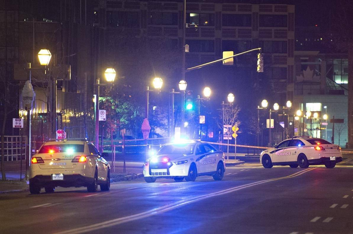 Police cars block the Quai Saint-Andre sweet where they arrested a man in medieval disguise, early Sunday, November 1, 2020 in Quebec City. Two people are dead and five people were injured after they were stabbed. THE CANADIAN PRESS/Jacques Boissinot