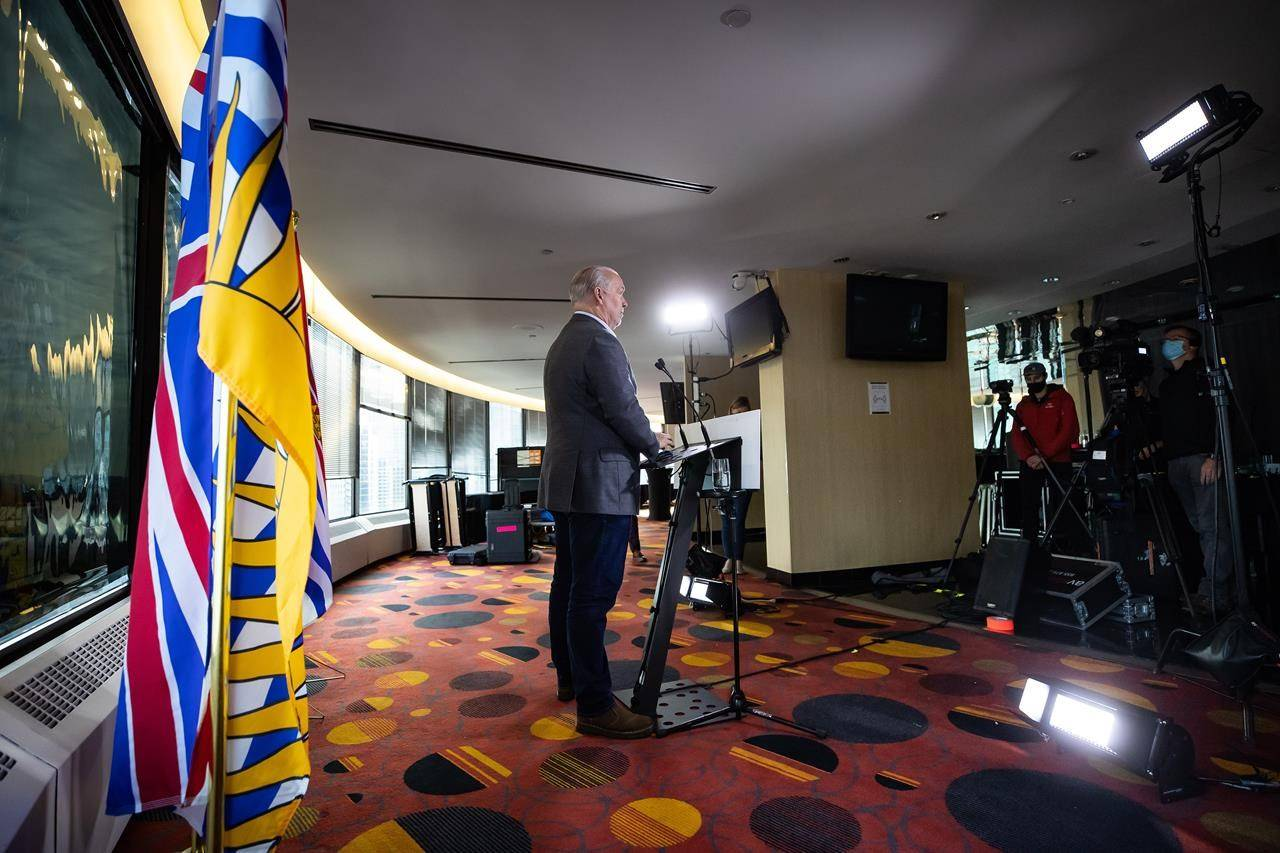 B.C. Premier John Horgan listens during a postelection news conference in Vancouver on Sunday, October 25, 2020. Horgan lost seven ministers who didn't seek re-election as he looks at putting together a new cabinet following the NDP's majority election win last week. THE CANADIAN PRESS/Darryl Dyck