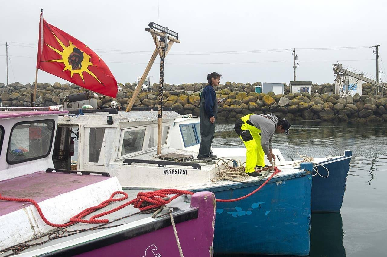 Indigenous fishermen adjust lines on their boat in Saulnierville, N.S. on Wednesday, Oct. 21, 2020. THE CANADIAN PRESS /Andrew Vaughan