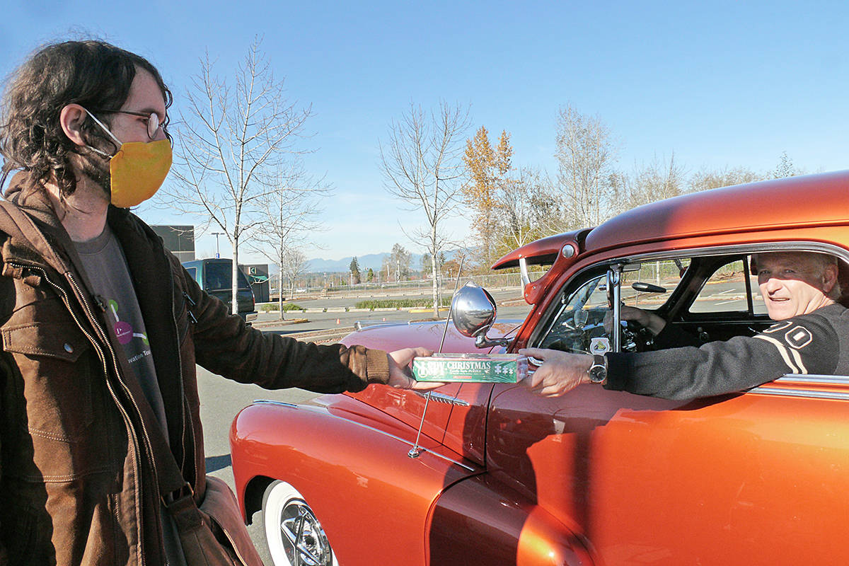 A driver dropped off a donation Sunday, Nov. 1, 2020 at the 37th annual Kruise for Kids toy drive and fundraiser held at the Langley Events Centre for the Lower Mainland Christmas Bureau(Dan Ferguson/Langley Advance Times)