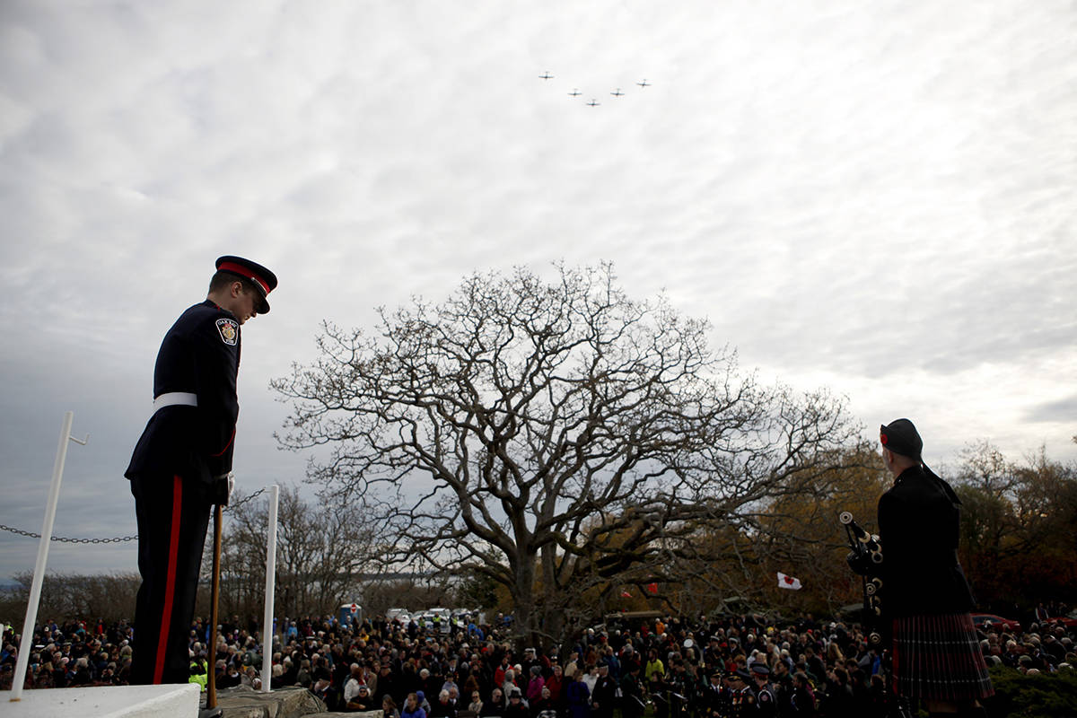 Planes fly in formation above a large crowd who gathered to honour the fallen during a Remembrance Day ceremony at the War Memorial in Oak Bay, B.C., on Monday, November 11, 2019. THE CANADIAN PRESS/Chad Hipolito