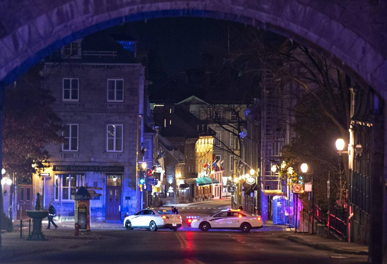 Police cars block the Saint-Louis Street near the Chateau Frontenac, early Sunday, November 1, 2020 in Quebec City. Extra mental health supports are available for those in Quebec's capital, which was shaken by a deadly sword attack on Halloween night. THE CANADIAN PRESS/Jacques Boissinot