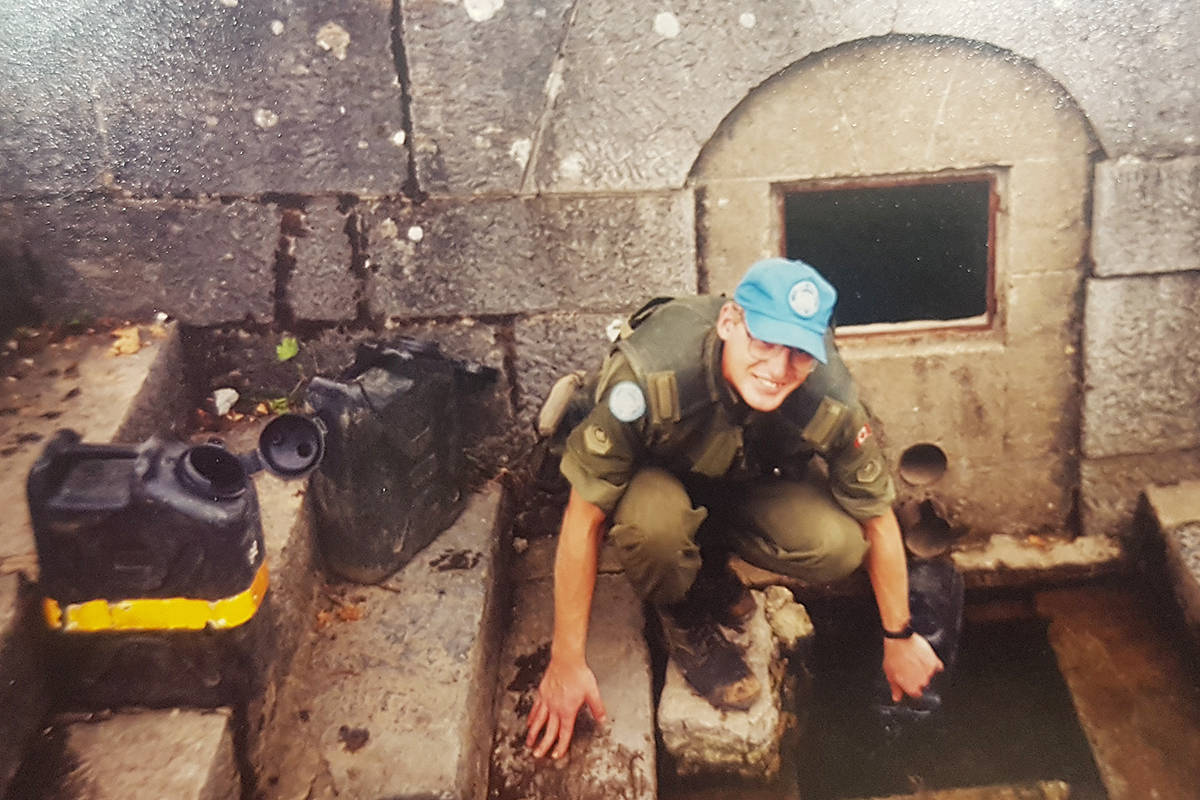 A young Master Cpl. Richard Jolly fills water jugs at a location outside Medak, Croatia in 1993. He and other members of Princess Patricia's Canadian Light Infantry (PPCLI) second battalion would battle a Croatian army bent on the 'ethnic cleansing' of Serbs. (Courtesy Richard Jolly)