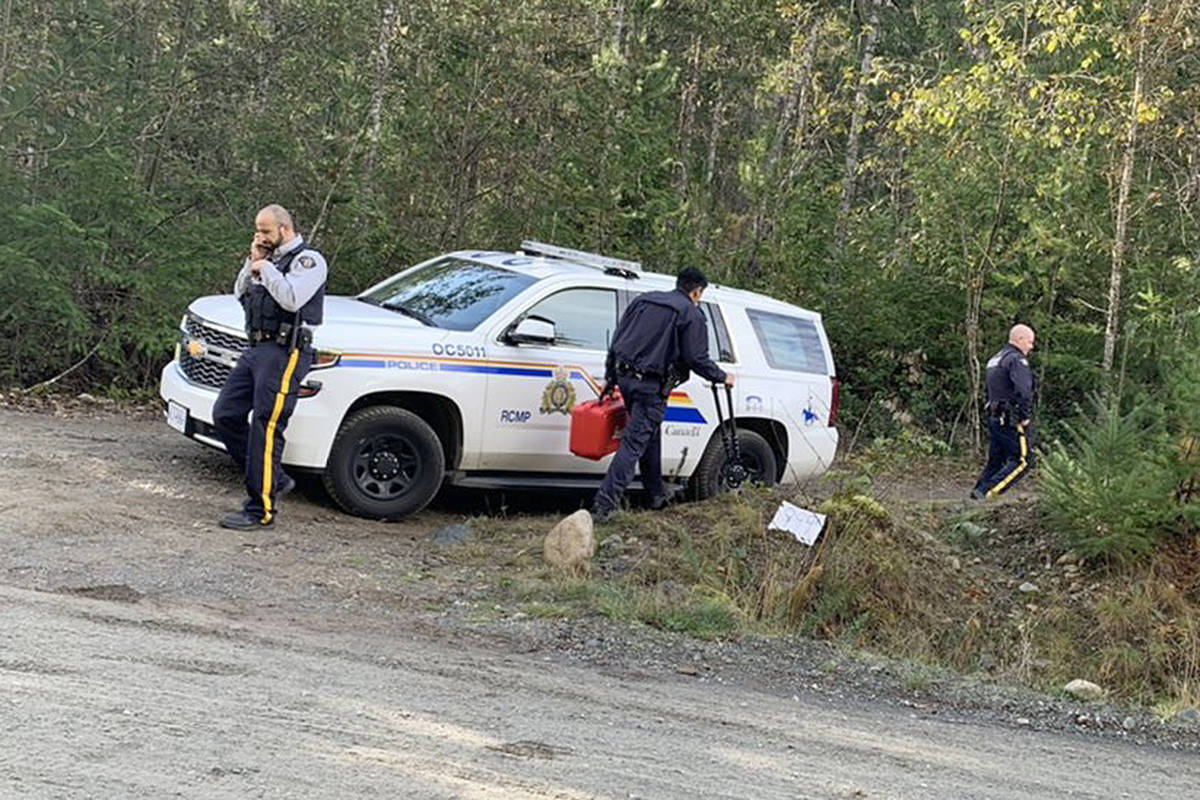 A police vehicle blocks access to a dirt road near Whiskey Creek on Monday, Nov. 2, 2020. Three bodies were discovered in a gravel pit on Sunday, Nov. 1. (Mandy Moraes photo)