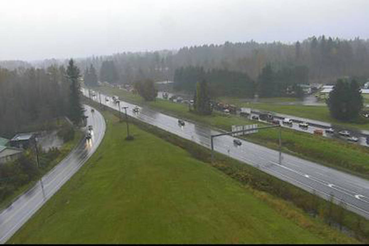 A stalled vehicle westbound on the Trans-Canada Highway just west of 264th Street is causing delays to traffic on the morning of Tuesday, Nov. 3, 2020. (Drive BC)