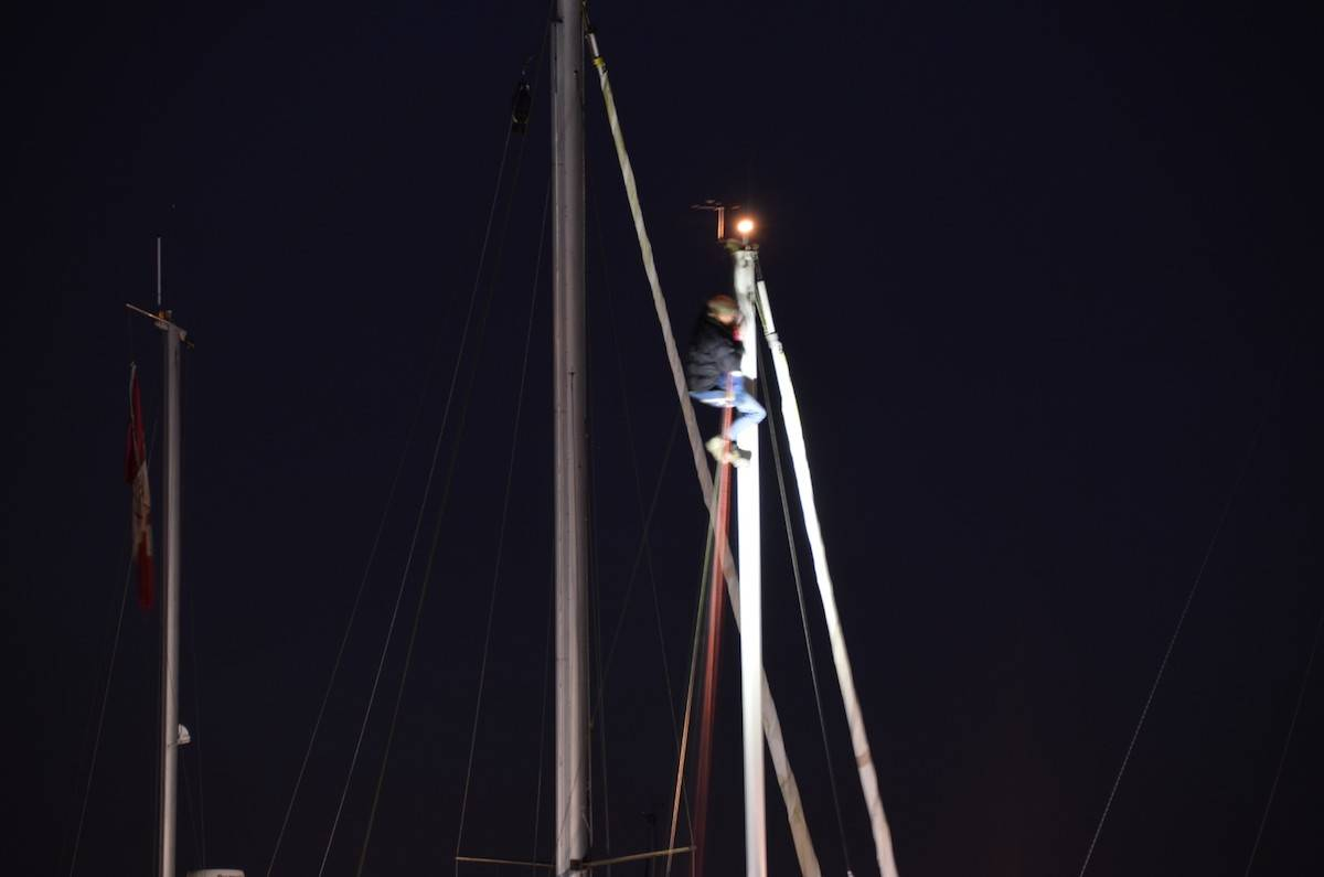Woman at the top of the sailboat mast in the marina at Nico Wynd Estates in South Surrey on Monday, Nov. 2. (Photo: Curtis Kreklau/South Fraser News Services)