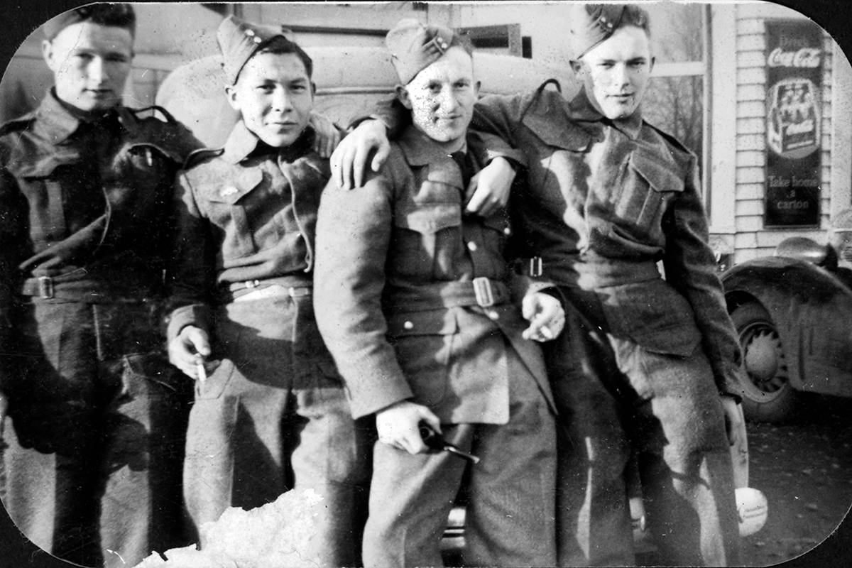 Canadian Army recruits (left to right) George Hadden, Tommy Fillardeau, Bob Brown, and James Hadden photographed outside Fort Langley's Edal Cafe in January 1943. The Hadden brothers were both killed in action during the Allied invasion of Normandy in 1944. (Langley Centennial Museum)