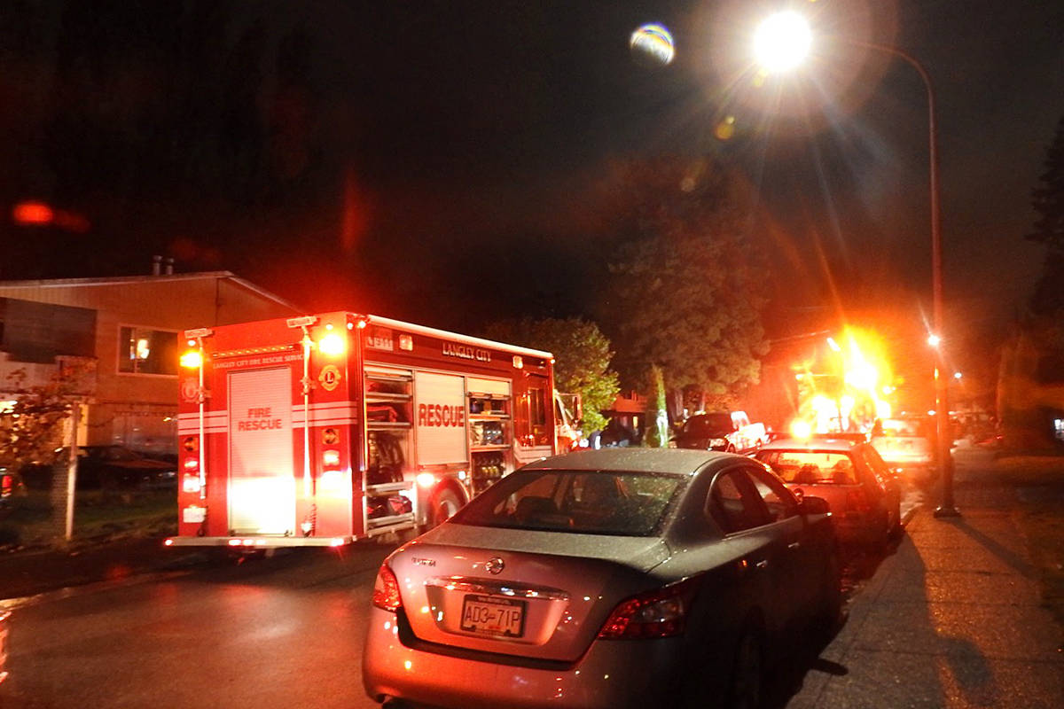Crews were trying to clear a Langley City house of smoke, after a fire was reported during the dinner hour Tuesday on 52nd Avenue, just west of 203rd Street. (Lisa Farquharson/Langley Advance Times)
