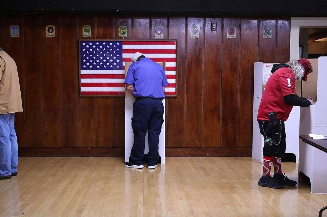 Voters fill out their ballots at American Legion Post 1 on Election Day in Tulsa, Okla. Tuesday, Nov. 3, 2020. THE CANADIAN PRESS/AP, Mike Simons/Tulsa World