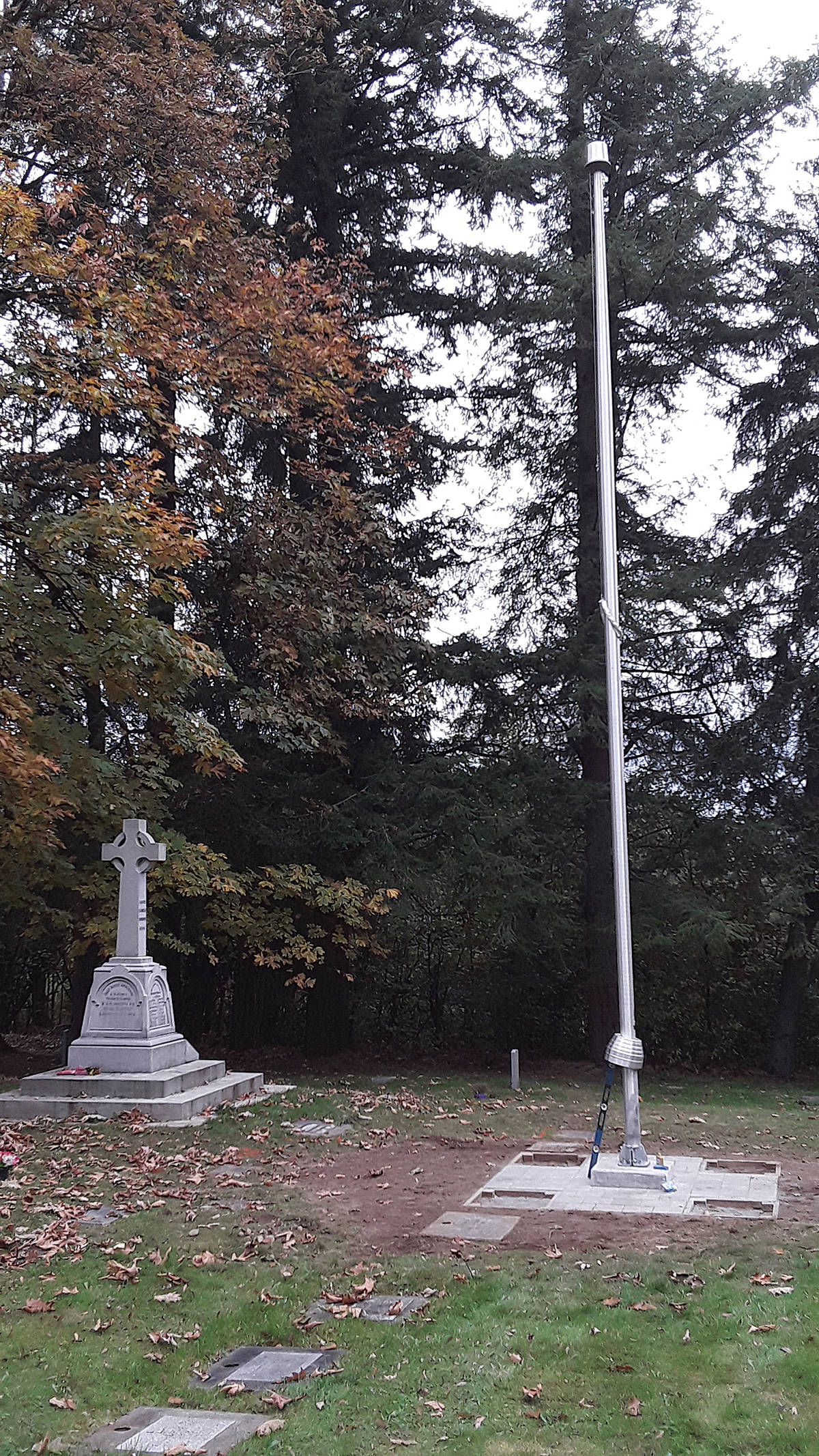 A flagpole has been erected, just in time for Remembrance Day, at the Murrayville cemetery, next to the cenotaph. It was paid for by the Froese family, as a tribute to the late Debbie Froese. (Special to Langley Advance Times)