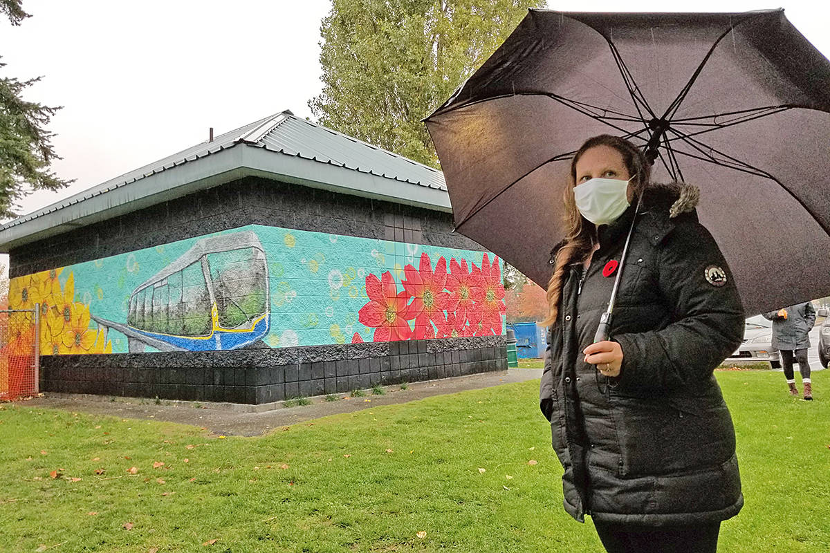 Artist Judy Pohl attended the unveiling her transportation-themed mural at Langley City's Linwood Park on Tuesday, Nov. 3, 2020 (Dan Ferguson/Langley Advance Times)